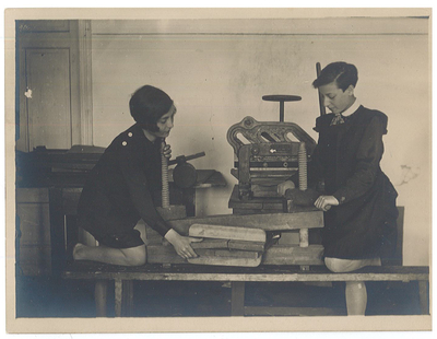 Students learning bookbinding skills in a Yiddish secular school in Bialystok, c. 1930.